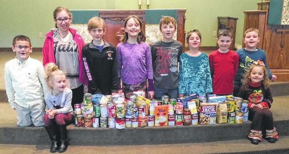 Salem Lutheran School students recently collected food and money for the Salem Food Bank. Students collected more than 100 food items and more than $200 as part of their weekly chapel offering. Photo: Photo Provided