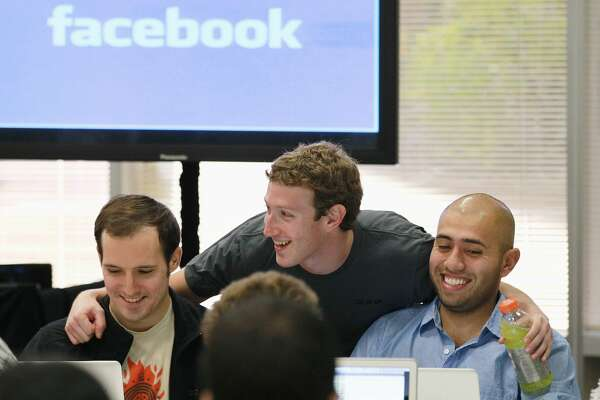 Mark Zuckerberg interacts with employees at Facebook.