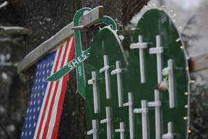 Snow falls onto a commemorative memorial near the firehouse in Sandy Hook, Conn. on Saturday, Dec. 14, 2013, the one-year anniversary of the Sandy Hook Elementary School shooting that killed 26 students and educators. Snow fell on the town Saturday, casting a somber mood as residents remembered the tragedy one year ago.