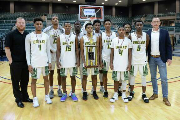 The Klein Forest Golden Eagles pose with the second place trophy for the Gold Bracket of the ConocoPhillips Katy ISD Classic on Saturday December 1, 2018 at the Leonard Merrell Center, Katy, TX.