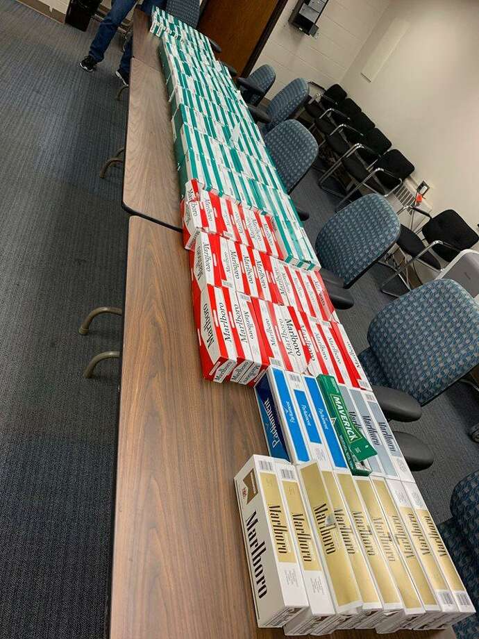 Police seized gambling records, nearly 150 cartons of untaxed cigarettes and more than $780 during a traffic stop on Friday. Photo: / Contributed Photo /Stamford Police Facebook