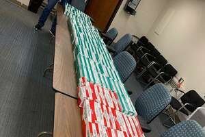 Police seized gambling records, nearly 150 cartons of untaxed cigarettes and more than $780 during a traffic stop on Friday.
