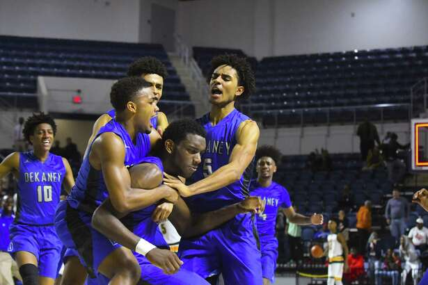 Former Dekaney player (1) Malcom Epps is celebrating with his by teammates after making the game winning 3 points basket in the playoffs with 2 seconds left in the game, in a highly contested game against Klein Forest last year.