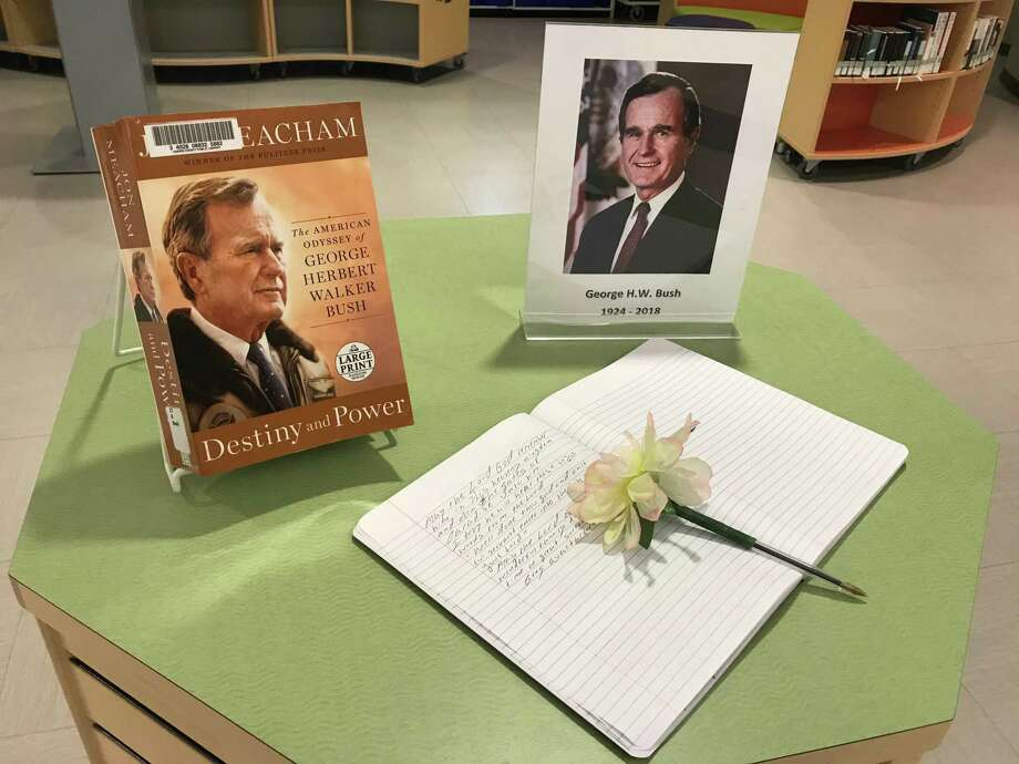 "The Barbara Bush Library displayed a notebook for messages to be written alongside a copy of ""Destiny and Power"" by Jon Meacham, a biography about President Bush. Photo: Chevall Pryce"
