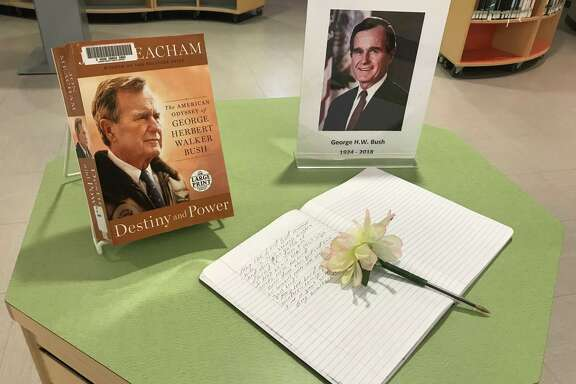 "The Barbara Bush Library displayed a notebook for messages to be written alongside a copy of ""Destiny and Power"" by Jon Meacham, a biography about President Bush."