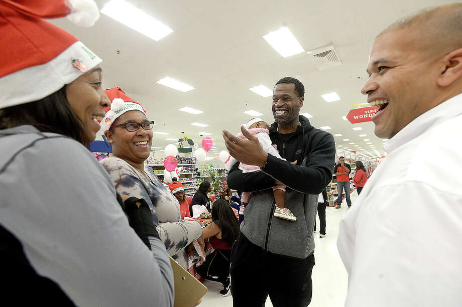 Stephen Jackson jokes with (from left) Bianca Dixon, Dawndre Bazile and Port Arthur Mayor Derrick Freeman during the Christmas with a Champion event at Target Saturday. The Port Arthur native and former NBA champion donated gift cards to 100 families to purchase gifts for the holidays. Photo taken Saturday, December 8, 2018 Kim Brent/The Enterprise Photo: Kim Brent/The Enterprise
