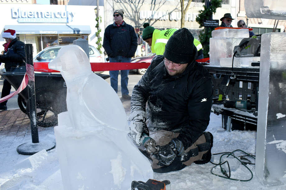 Eight professional ice carvers transformed 3 blocks of ice-900 pounds-into a spectacular sculpture in only four hours on Saturday, December 8 at The Shops at Yale in New Haven. The event included hot cocoa, crepes and live performances by several a cappella groups- Were you SEEN? Photo: Lara Green- Kazlauskas/ Hearst Media