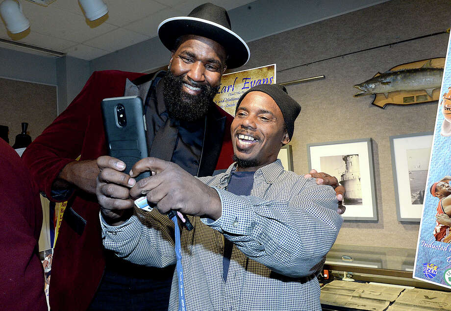 Kendrick Perkins poses for a picture with fan Ron Lyons during the induction ceremony into the Sports Hall of Fame at the Museum of the Gulf Coast Saturday. Family, friends and fans packed the auditorium for the event, in which the 2003 Ozen graduate and Earl Evans of Lincoln High School's class of 1974 were both honored. Both went on from prominent high school careers to playing in the NBA. Photo taken Saturday, December 8, 2018 Kim Brent/The Enterprise Photo: Kim Brent/The Enterprise