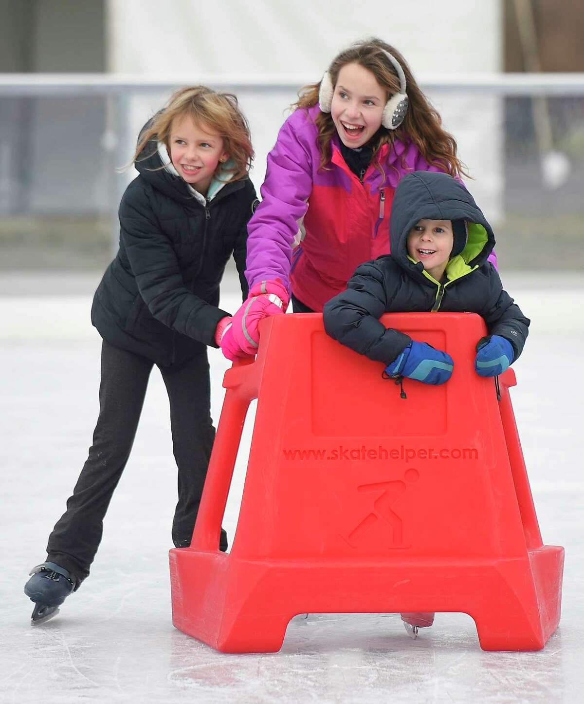 Stamford siblings Julia Keenan, left, 8, Emily Keenan, 12, and Brian Keenan, 4, skate together at the Steven & Alexandra Cohen Skating Center at Mill River Park in Stamford, Conn. Sunday, Dec. 9, 2018. The new 9,000 sq. ft. skating area opened Thursday and will be open seven days a week seasonally through March 15.