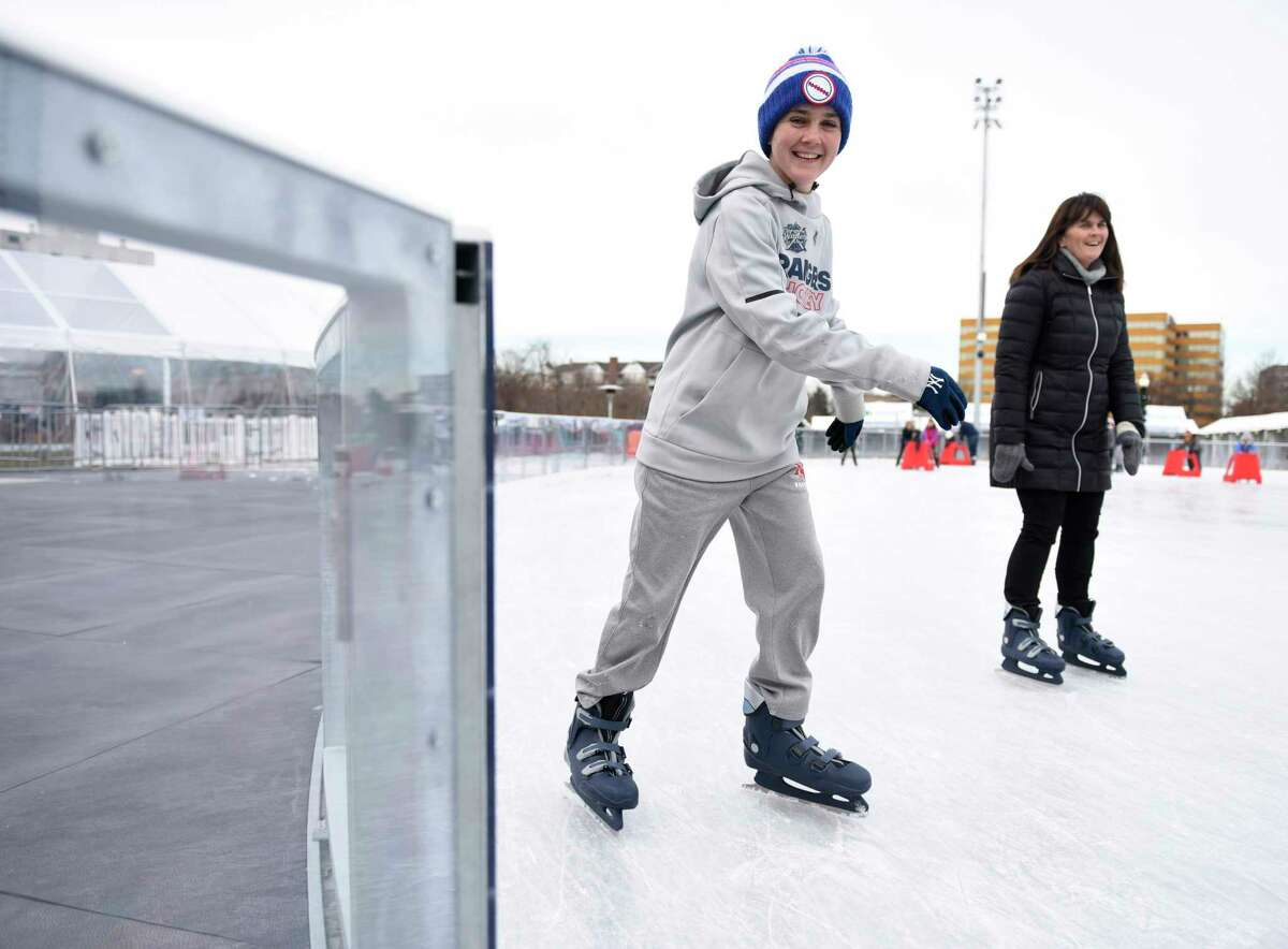 New Canaan's Matthew Balkun, 15, skates with his mother, Mary Balkun, at the Steven & Alexandra Cohen Skating Center at Mill River Park in Stamford, Conn. Sunday, Dec. 9, 2018. The new 9,000 sq. ft. skating area opened Thursday and will be open seven days a week seasonally through March 15.