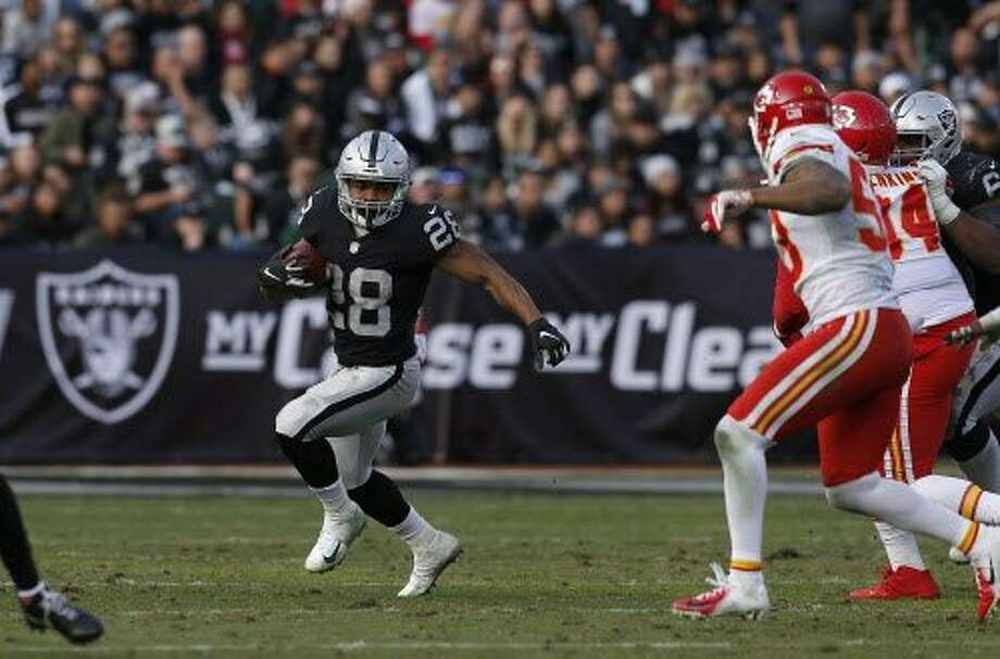 Oakland Raiders running back Doug Martin (28) runs against the Kansas City Chiefs during an NFL football game in Oakland, Calif., Sunday, Dec. 2, 2018. (AP Photo/D. Ross Cameron) Photo: D. Ross Cameron / Associated Press