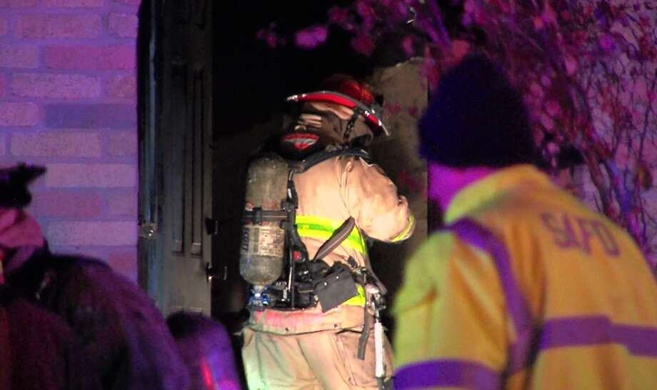 San Antonio firefighters found a man inside a bathroom after they responded to a house fire on the West Side overnight, Sunday, Dec. 9, 2018. Officials report the unidentified man died at the scene. Photo: 21 Pro Video