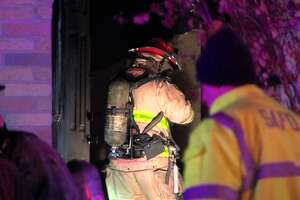 San Antonio firefighters found a man inside a bathroom after they responded to a house fire on the West Side overnight, Sunday, Dec. 9, 2018. Officials report the unidentified man died at the scene.