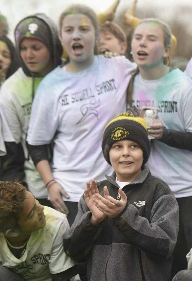 Steven Sudell, an eighth-grader who is battling brain cancer, poses with his classmates after the Sudell Sprint color run at Western Middle School in Greenwich, Conn. Wednesday, Nov. 22, 2017. Eighth-graders raised $8,000 for the family of Steven Sudell and put on a color run from the school to Hamill Rink in his honor with a pizza and ice cream party afterwards. Photo: Tyler Sizemore / Hearst Connecticut Media / Greenwich Time