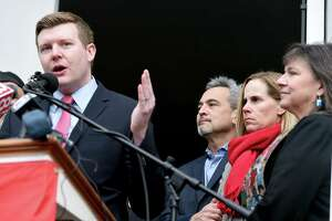 State Representative Sean Scanlon (left) speaks at a press conference about gun safety in front of First Congregational Church across from the Guilford Green on November 27, 2018 following the death of Ethan Song. From left are Scanlon, Ethan's parents, Michael and Kristin Song, and Rev. Ginger Brasher-Cunningham.