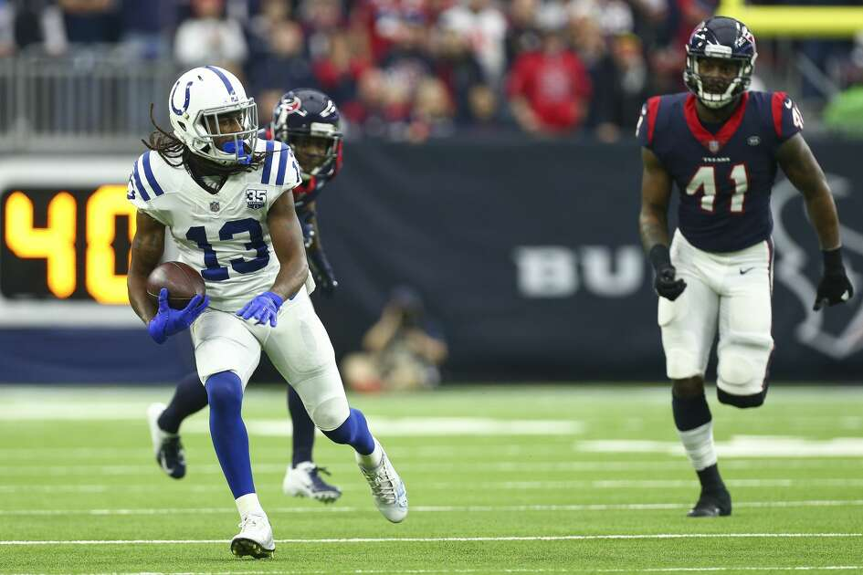 Indianapolis Colts wide receiver T.Y. Hilton (13) runs after making a catch against the Houston Texans during the second quarter of an NFL game at NRG Stadium Sunday, Dec. 9, 2018, in Houston. The Colts won 24-21.