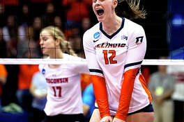 Ashlyn Fleming of Illinois celebrates during her team's victory over Wisconsin in their NCAA volleyball quarterfinal matchup Saturday at Huff Hall.