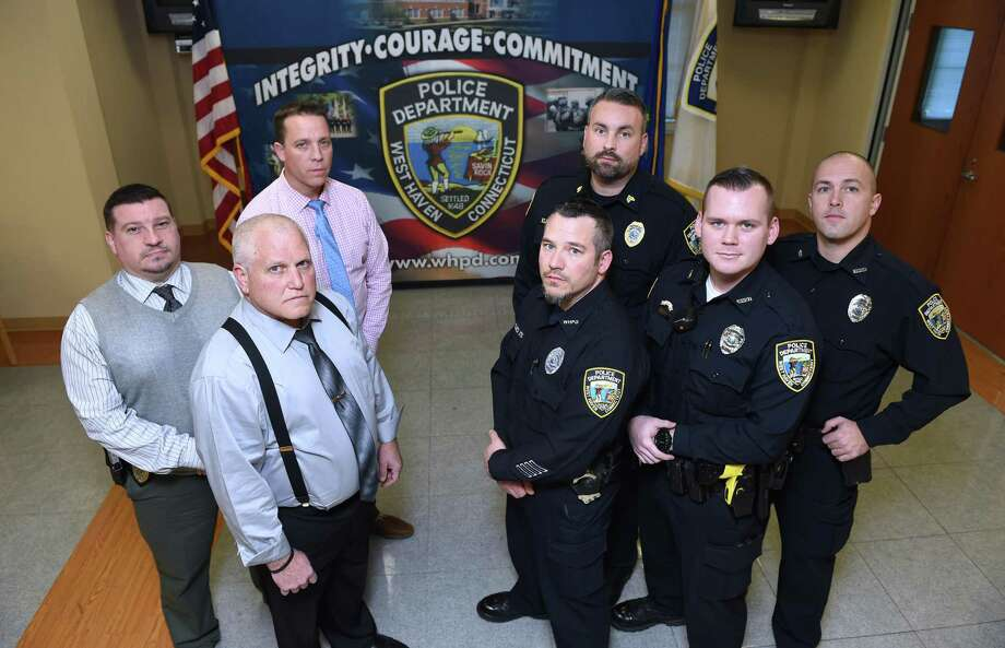 Clockwise from far left, Capt. Carl V. Flemmig, Detective Sean Faughnan, Training Sgt. Scott Kleinknecht, Officer Craig Thompson, Officer Paul Butler, Officer Scott Allard and Dep. Chief Joseph Perno at the West Haven Police Department recently. Photo: Arnold Gold / Hearst Connecticut Media / New Haven Register