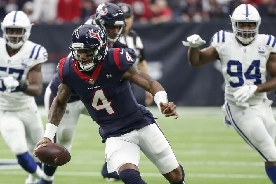 Houston Texans quarterback Deshaun Watson (4) scrambles out of the pocket away from Indianapolis Colts defensive ends Tyquan Lewis (94) and Kemoko Turay (57) during the first quarter of an NFL football game at NRG Stadium on Sunday, Dec. 9, 2018, in Houston.