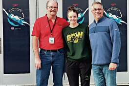 Midland's Claire Newman is shown with her coach, Chilly Smith, left, and her father, Jeff Newman, outside the Greensboro Aquatic Center, where she competed in the Junior Nationals on Thursday and Friday.