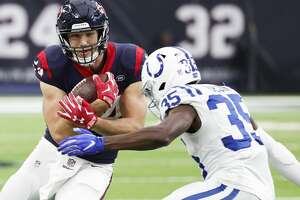 Houston Texans tight end Ryan Griffin (84) is hit by Indianapolis Colts cornerback Pierre Desir (35) as he makes a first down reception during the third quarter of an NFL football game at NRG Stadium on Sunday, Dec. 9, 2018, in Houston.