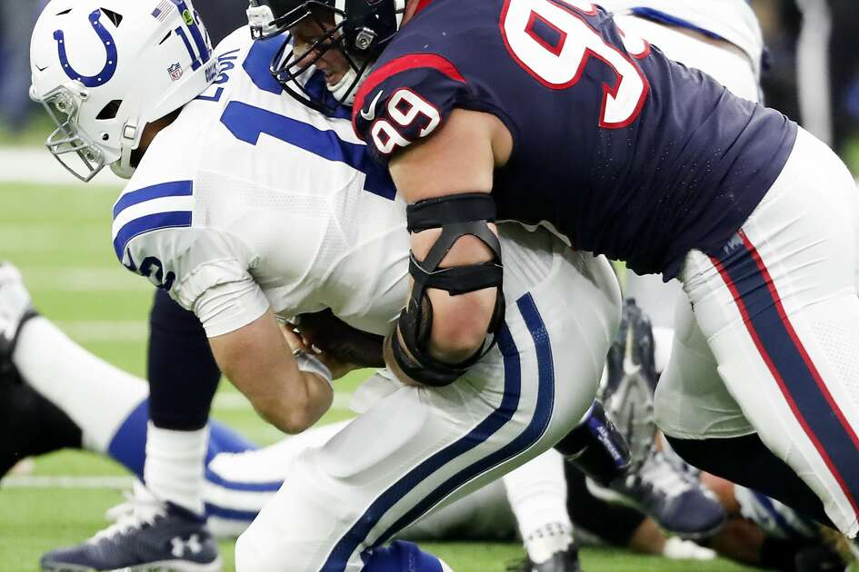 Houston Texans defensive end J.J. Watt (99) sacks Indianapolis Colts quarterback Andrew Luck (12) during the third quarter of an NFL football game at NRG Stadium on Sunday, Dec. 9, 2018, in Houston.