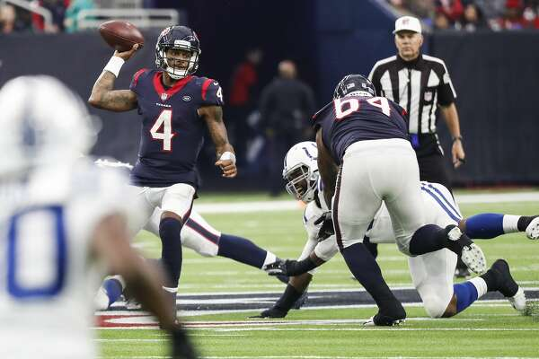 Houston Texans quarterback Deshaun Watson (4) scrambles around in the pocket as he is pressured by the Indianapolis Colts defense during the fourth quarter of an NFL football game at NRG Stadium on Sunday, Dec. 9, 2018, in Houston.