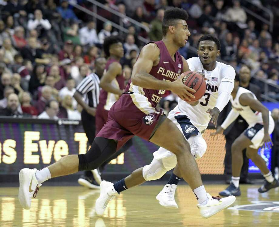 Florida State guard Anthony Polite is pressured by UConn's Alterique Gilbert during Saturday's game. Photo: Bill Kostroun / Associated Press / Copyright 2018 The Associated Press. All rights reserved