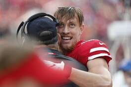 San Francisco 49ers tight end George Kittle is greeted on the bench after scoring a touchdown during the first half of an NFL football game against the Denver Broncos Sunday, Dec. 9, 2018, in Santa Clara, Calif. (AP Photo/Josie Lepe)