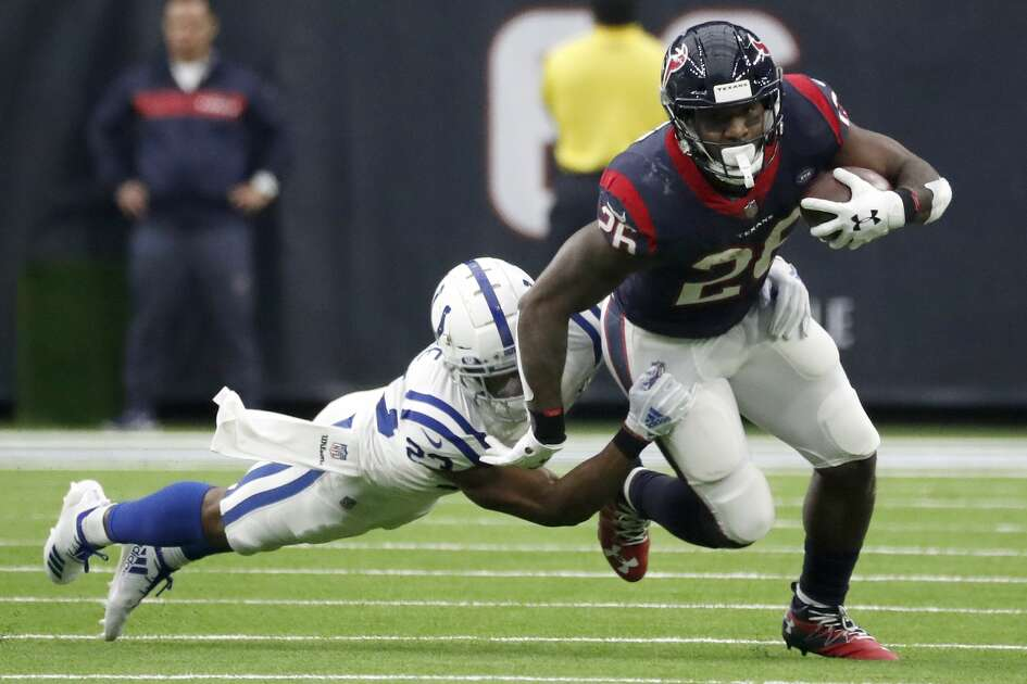 Houston Texans running back Lamar Miller (26) runs the ball against Indianapolis Colts cornerback Kenny Moore (23) during the second quarter of an NFL football game at NRG Stadium, Sunday, Dec. 9, 2018, in Houston.
