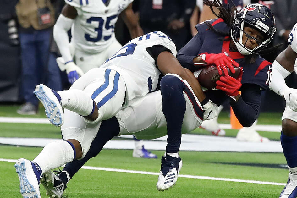 Houston Texans wide receiver DeAndre Hopkins (10) catches a pass up the middle during the first quarter of an NFL football game at NRG Stadium, Sunday, Dec. 9, 2018, in Houston.