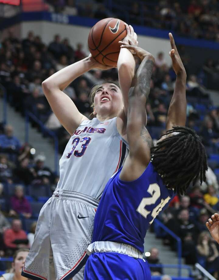 Connecticut's Katie Lou Samuelson (33) goes up for a shot and is fouled by Seton Hall's Shadeen Samuels (24) in the second half on Saturday in Hartford. UConn won 99-61. Photo: Stephen Dunn / Associated Press / Copyright 2018 The Associated Press. All rights reserved