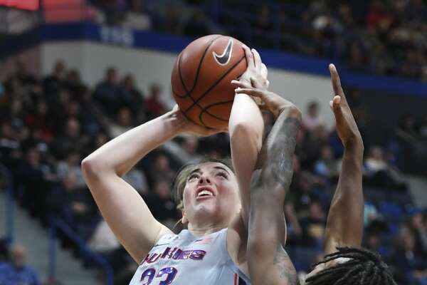 Connecticut's Katie Lou Samuelson (33) goes up for a shot and is fouled by Seton Hall's Shadeen Samuels (24) in the second half on Saturday in Hartford. UConn won 99-61.