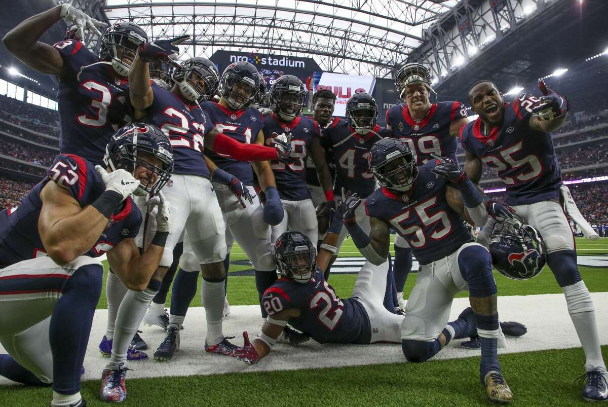 Houston Texans defensive players celebrate after an interception by defensive back Andre Hal (29) against the Indianapolis Colts during the second quarter of an NFL game at NRG Stadium Sunday, Dec. 9, 2018, in Houston. The Colts won 24-21.