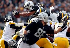 Oakland Raiders' Doug Martin dives for a touchdown in 1st quarter against Pittsburgh Steelers during NFL game at Oakland Coliseum in Oakland, Calif. on Sunday, December 9, 2018.