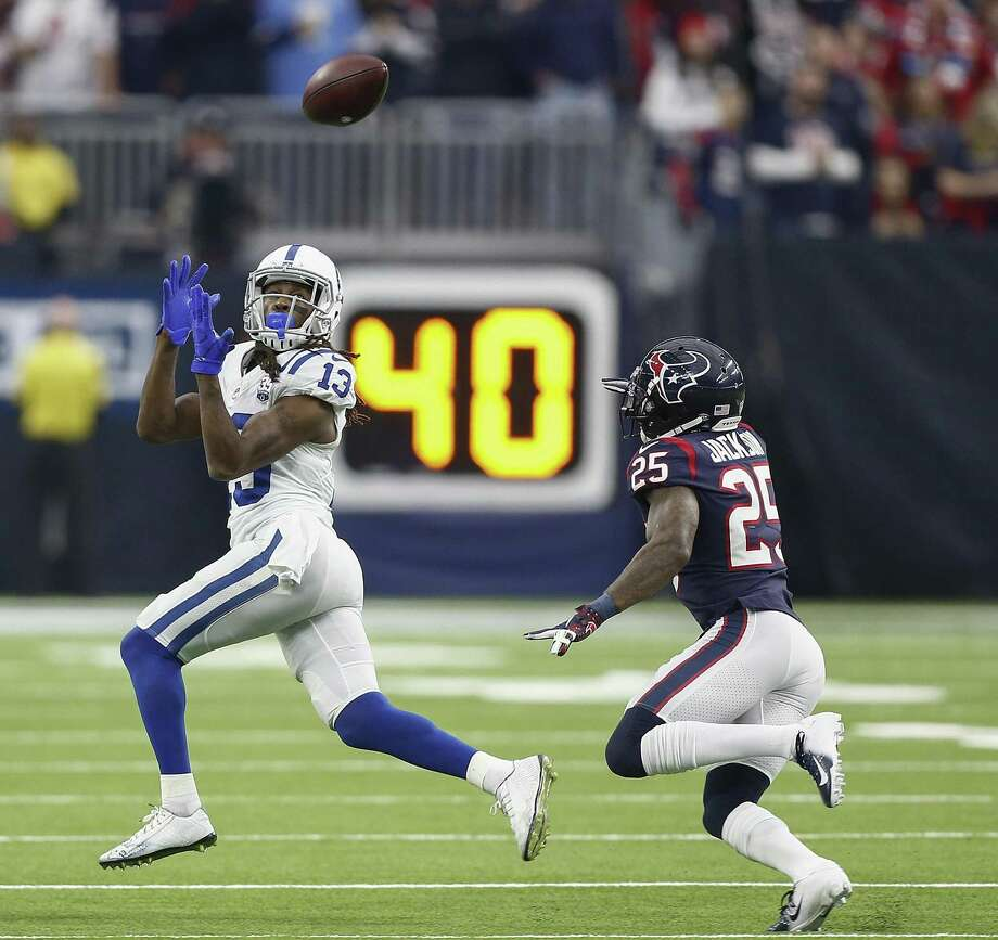 T.Y. Hilton (13) of the Indianapolis Colts catches a pass as he slips behind Kareem Jackson (25) of the Houston Texans during the fourth quarter at NRG Stadium on December 9, 2018 in Houston, Texas. Photo: Bob Levey, Stringer / Getty Images / 2018 Getty Images
