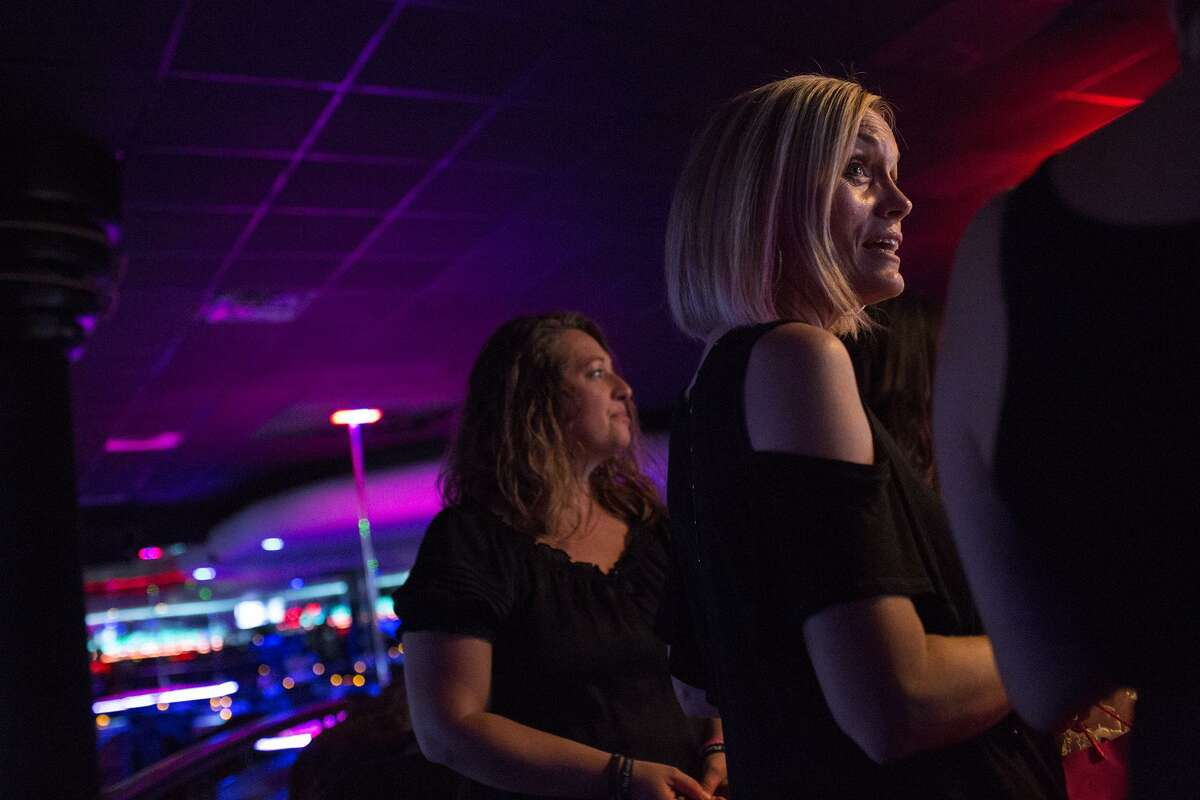 Lisa Michelle, right, founder of No Strings Attached, and volunteer Brook Singh, left, said they are not judgmental toward the dancers at the strip clubs. Their goal is to build the women up and help them realize there are other job options.