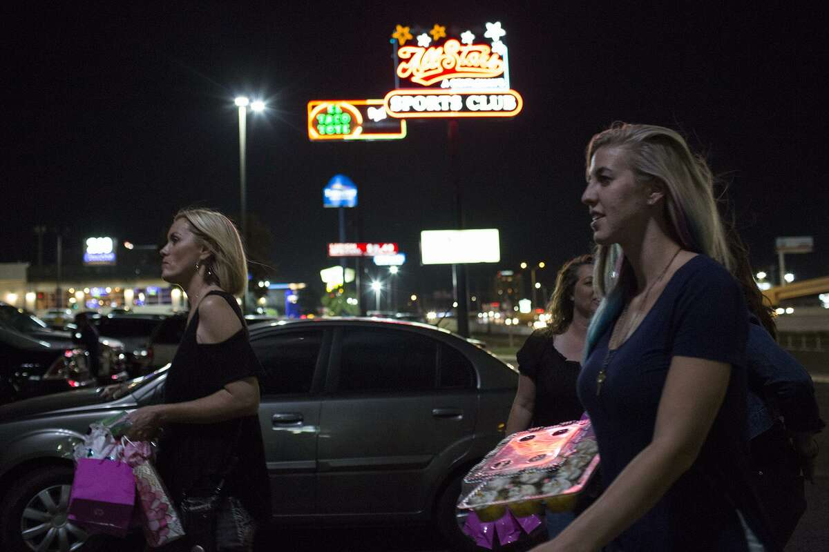 Lisa Michelle, from left, founder of No Strings Attached, a Christian outreach ministry, and volunteers Brook Singh and Mallory Champion walk to a strip club, where they will visit with the women working there.