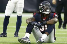 HOUSTON, TX - DECEMBER 09: Jadeveon Clowney #90 of the Houston Texans looks up at the videobord after he was called for a neutral zone infraction on a third and one during the fourth quarter against the Indianapolis Colts at NRG Stadium on December 9, 2018 in Houston, Texas. (Photo by Bob Levey/Getty Images)