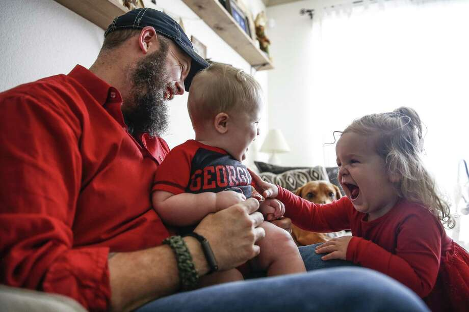 Dillon Bright laughs as Charlotte Bright, 2, right, tickles her nine-month-old brother, Mason Bright, Saturday, Nov. 3, 2018, in Tomball. Child Protective Services was hit with $127,000 in sanctions after improperly removing the Bright's children from their home after Mason fell and fractured his skull when he was five months old. Photo: Michael Ciaglo, Houston Chronicle / Staff Photographer / Michael Ciaglo
