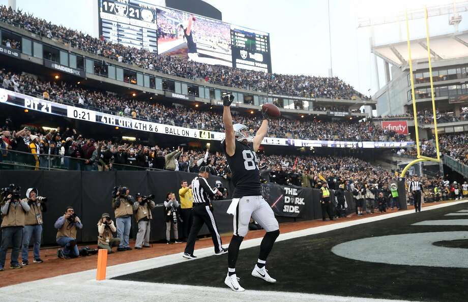 Oakland Raiders' Derek Carrier celebrates catching the go ahead touchdown in the final minute of the team's 24-21 win over Pittsburgh at the Coliseum on December 9, 2018. Photo: Scott Strazzante / The Chronicle 2018