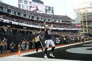 Oakland Raiders' Derek Carrier celebrates catching the go ahead touchdown in final minute of Raiders' 24-21 win over Pittsburgh Steelers  in NFL game at Oakland Coliseum in Oakland, Calif. on Sunday, December 9, 2018.