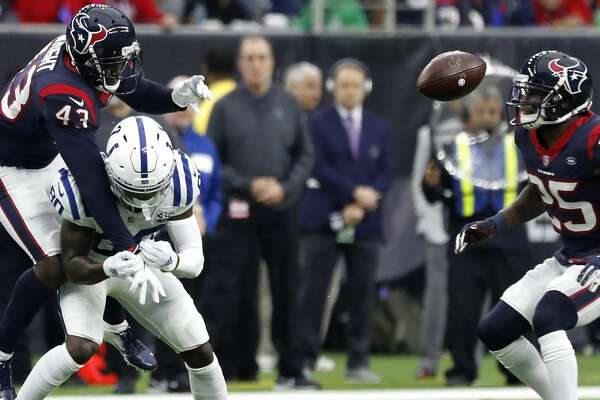 Houston Texans defensive back Shareece Wright (43) breaks up a pass intended for Indianapolis Colts wide receiver Chester Rogers (80) during the second quarter of an NFL football game at NRG Stadium, Sunday, Dec. 9, 2018, in Houston.