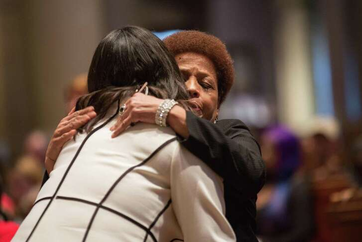 San Francisco Mayor London Breed (left) embraces Mattie Scott, a gun violence survivor and president of the S.F. chapter of the Brady Campaign, during the vigil to honor victims of gun violence at St. Ignatius Church.