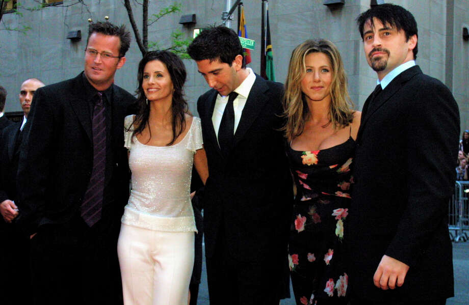 """FILE - In this May 5, 2002 file photo, the cast members, Matthew Perry, from left, Courteney Cox Arquettte, David Schwimmer, Jennifer Aniston and Matt LeBlanc of the television show """"Friends,"""" arrive at New York's Rockefeller Center for NBC's 75th Anniversary event. Netflix will still be there for fans of the old TV series """"Friends,"""" but maintaining the relationship will come at a steep price. The New York Times reported that Netflix paid $100 million to keep showing """"Friends"""" on its U.S. service through 2019. (AP Photo/Tina Fineberg, File) Photo: Tina Fineberg / AP2002"""