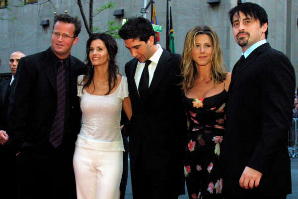 """FILE - In this May 5, 2002 file photo, the cast members, Matthew Perry, from left, Courteney Cox Arquettte, David Schwimmer, Jennifer Aniston and Matt LeBlanc of the television show """"Friends,"""" arrive at New York's Rockefeller Center for NBC's 75th Anniversary event. Netflix will still be there for fans of the old TV series """"Friends,"""" but maintaining the relationship will come at a steep price. The New York Times reported that Netflix paid $100 million to keep showing """"Friends"""" on its U.S. service through 2019. (AP Photo/Tina Fineberg, File)"""