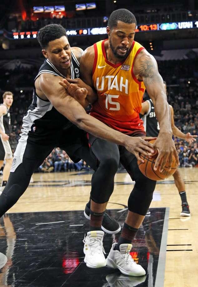 Rudy Gay #22 of the San Antonio Spurs tries to tie up Derrick Favors #15 of the Utah Jazz. Utah Jazz v San Antonio Spurs on Sunday, December 9, 2018 at the AT&T Center. Photo: Ronald Cortes/Contributor