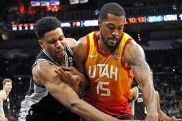 Rudy Gay #22 of the San Antonio Spurs tries to tie up Derrick Favors #15 of the Utah Jazz. Utah Jazz v San Antonio Spurs on Sunday, December 9, 2018 at the AT&T Center.
