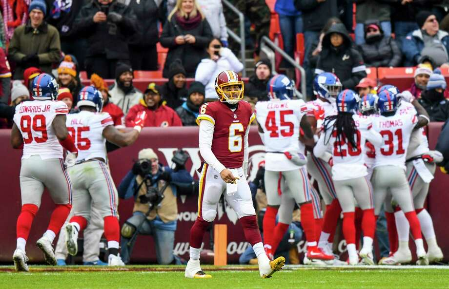 Redskins quarterback Mark Sanchez (6) walks off the field throwing an interception for a touchdown in the first quarter of Sunday's loss. Photo: Washington Post Photo By Jonathan Newton / The Washington Post