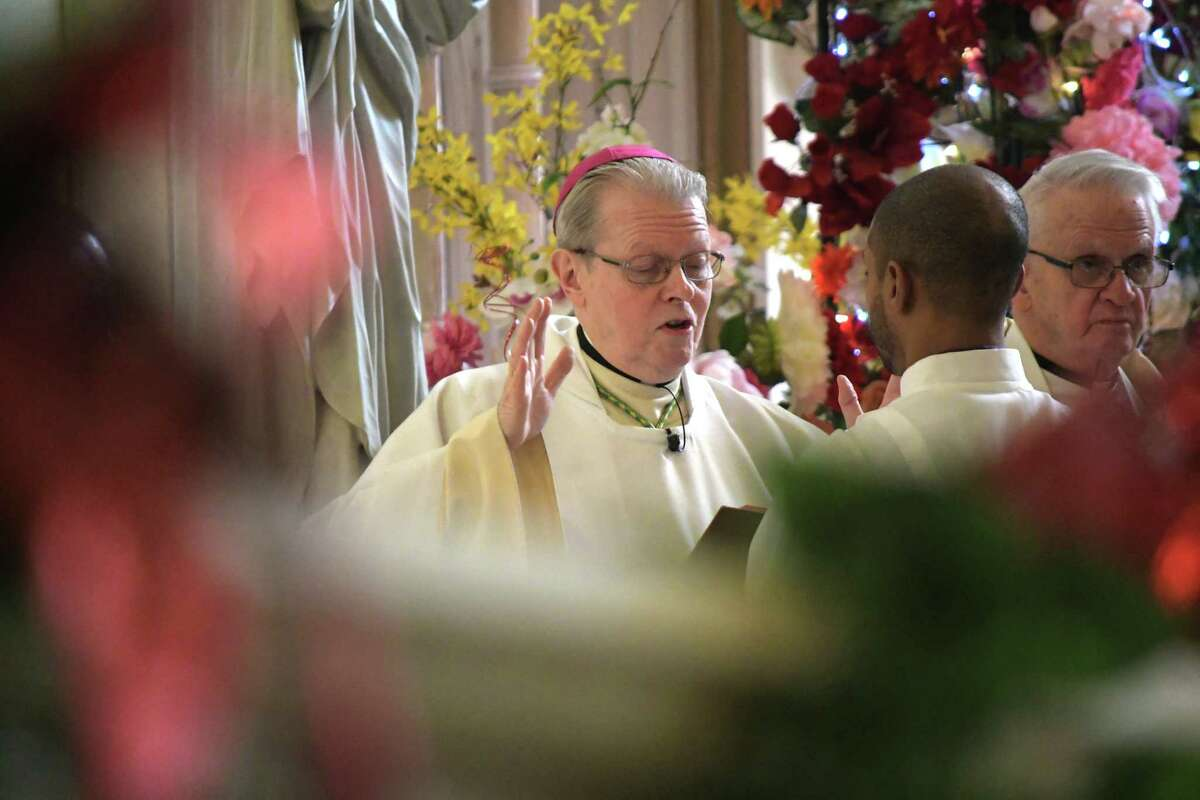 Bishop Edward Scharfenberger leads a Mass at the Shrine Church of Our Lady of the Americas for the Feast of Our Lady of Guadalupe on Sunday, Dec. 9, 2018, in Albany, N.Y. (Paul Buckowski/Times Union)